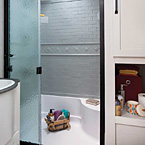 "Baths include a 32"" x 40"" shower with built-in seat, glass door, skylight, plus plenty of storage"