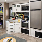 "Kitchens feature a 1.3 Cu. ft., stainless steel microwave, 3-Burner stove/21"" oven with backlit controls and glass cover.