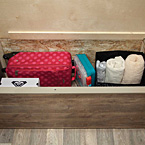 Smooth, finished edge underbed storage protects delicate items